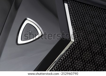 Fragment of a front panel of the computer casing. The switching on button on a front panel of the computer casing. Black computer casing.  - stock photo