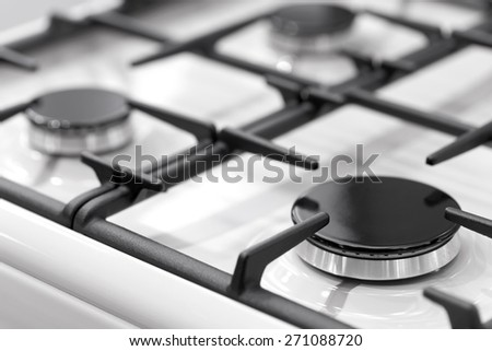 Fragment of a gas kitchen stove  - stock photo