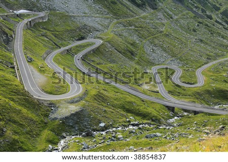 Fragment of a high altitude road in the mountains.Location:Transfagarasan road the highest road in Romania. - stock photo