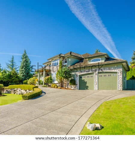 Fragment of a luxury house with a garage door in Vancouver, Canada. Horizontal orientation. - stock photo