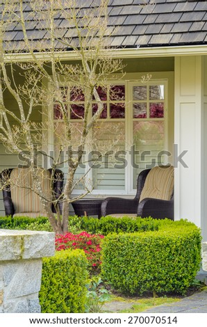 Fragment of a luxury house with chairs in front of the window in Vancouver, Canada. - stock photo