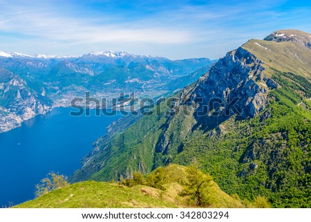 Fragment of a nice mountain view Garda Lake from the trail at Monte Baldo in Italy. - stock photo