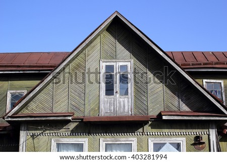 Fragment of a roof of the old wooden house