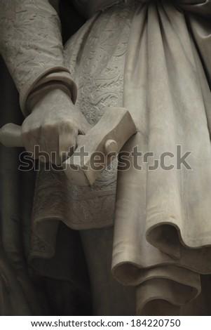 fragment of a statue of Donatello. Statue outside the Uffizi. Florence, Italy  - stock photo