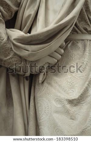 fragment of a statue of Michelangelo Buonarroti.  Statue outside the Uffizi, Florence, Italy - stock photo