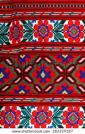 Fragment of a traditional ornament on a bright  Belorussian towel
