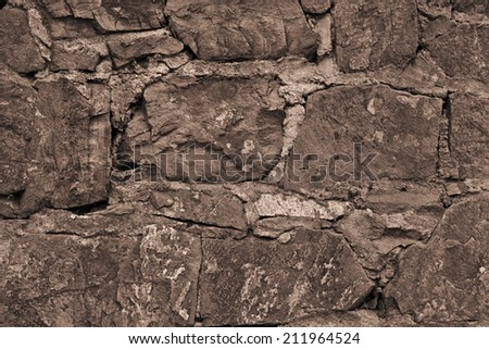 Fragment of a wall from a chipped stone, Rocks wall overgrown with moss and fungi found on high elevation in Alps mountains - stock photo