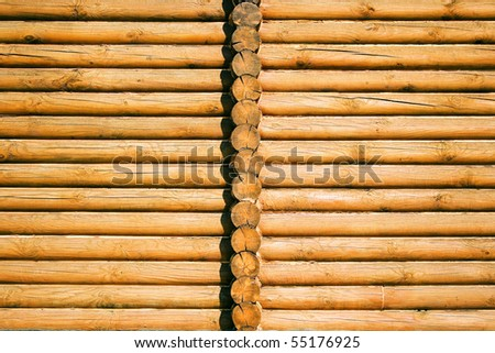 Fragment of a wooden house, with a ledge, as a background - stock photo