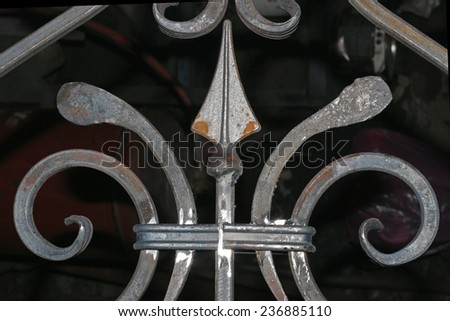 fragment of a wrought-iron fence - stock photo