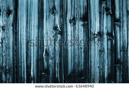 Fragment of an abstract wooden wall close up - stock photo