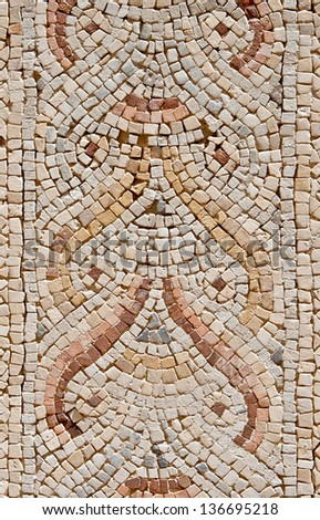 Fragment of an ancient  floor mosaic. Colorful small tiles, unusual geometric image, oval forms in ornament. Synagogue. Israel  - stock photo