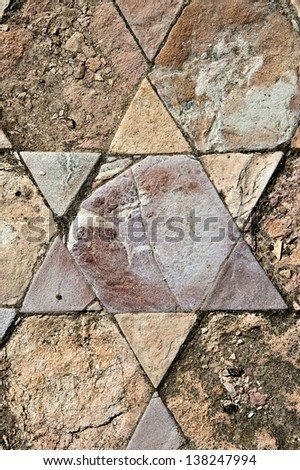 Fragment of an ancient  floor mosaic. Colorful stones of different forms, geometric ornament with Stars of David. Courtyard  of St.Euthymius Monastery. Israel - stock photo