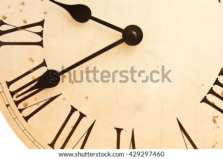Fragment of an old clock face with Roman numerals - stock photo