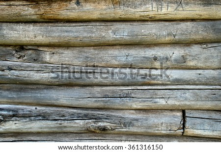 Fragment of an old timbered wall.Wood is corroded wreckers. - stock photo
