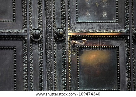 fragment of antique brass door with ornaments, close-up - stock photo