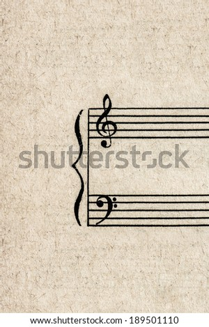 fragment of antique paper sheet for musical notes. grungy background - stock photo
