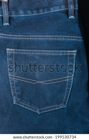 fragment of back pocket blue jeans, background - stock photo