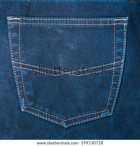 fragment of back pocket blue jeans, background, closeup - stock photo