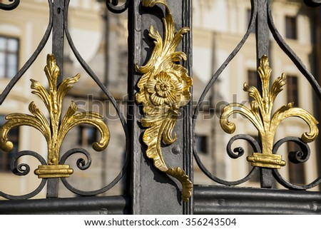 Fragment of baroque metal gate , gold leaf, manual work of blacksmith. Baroque in Europe