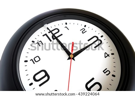 Fragment of big round wall clock, with a black rim isolated on white background close-up and arrows showing three o'clock isolated on white close-up - stock photo