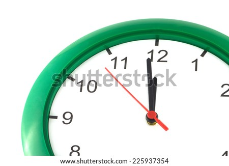Fragment of big wall clock with green case shows almost twelve o'clock isolated on white close up - stock photo