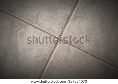 Fragment of ceramic tiles floor. - stock photo