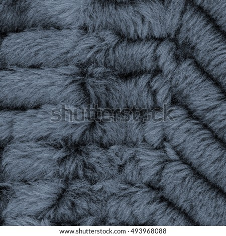 fragment of coat as blue natural fur background