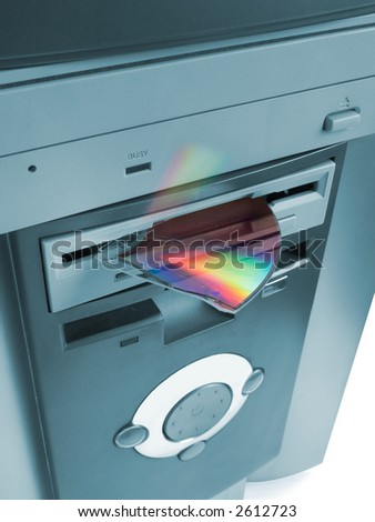 Fragment of compact disk in floppy drive - stock photo