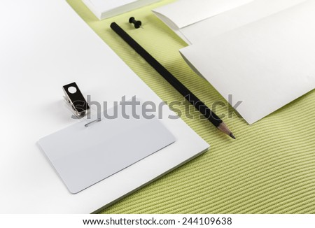 Fragment of corporate identity on a green background. - stock photo