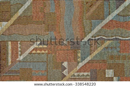 Fragment of decorative carpet fabric pattern in retro style with  abstract  graphical  ornament in dull colors.  - stock photo