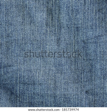 fragment of dirty blue jeans fabric - stock photo