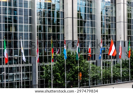Fragment of European Parliament Buildings, European symbols and flags. Brussels, Belgium. - stock photo