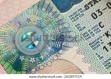 Fragment of European Schengen Visa in a passport page - macro background - stock photo