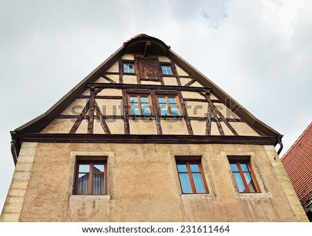 Fragment of facade of medieval house in old town Rothenburg ob der Tauber, Bayern, Germany - stock photo