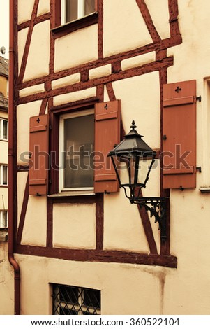 Fragment of facade of medieval house with lantern in old town Nuremberg, Germany - stock photo