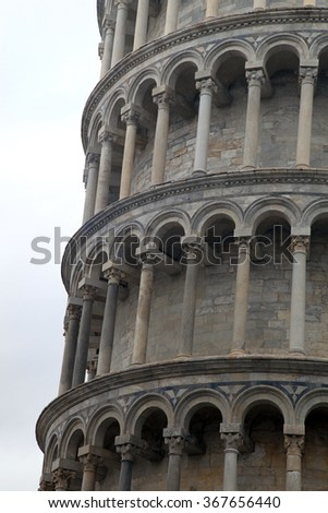Fragment of famous Leaning Tower of Pisa, Italy - stock photo