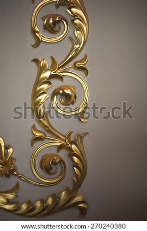 Fragment of golden floral  ornament. - stock photo
