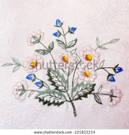 Fragment of handmade retro tapestry textile pattern with floral ornament useful as background