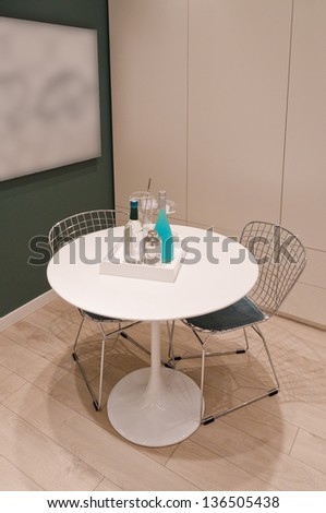 Fragment of Interior design of a modern living room with a table and two chairs - stock photo