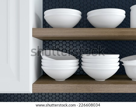 Fragment of interior of modern black and white kitchen. Kitchenware on the wooden shelves. - stock photo