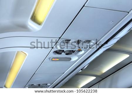 Fragment of   interior view of modern Airplane. International line. - stock photo