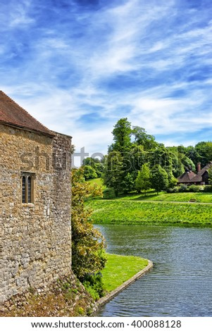 Fragment of Leeds Castle in a lake in Kent in England. The castle was built in the twelfth century as a king residence. Now it is open to the public. - stock photo