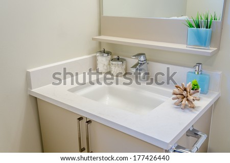 Fragment of luxury bathroom with a sink and wooden cabinet