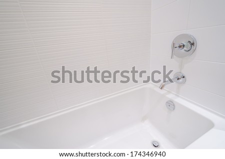 Fragment of luxury bathroom with two sinks and wooden cabinets - stock photo