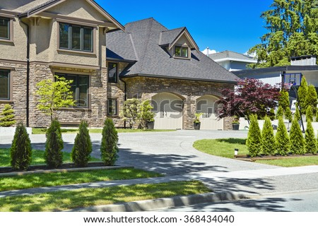Asphalt driveway house stock images royalty free images for Garage door repair round lake il
