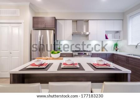 Fragment of modern kitchen in luxury house - stock photo