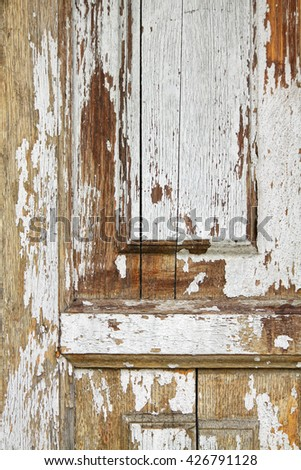 fragment of old wooden door with cracked paint - stock photo