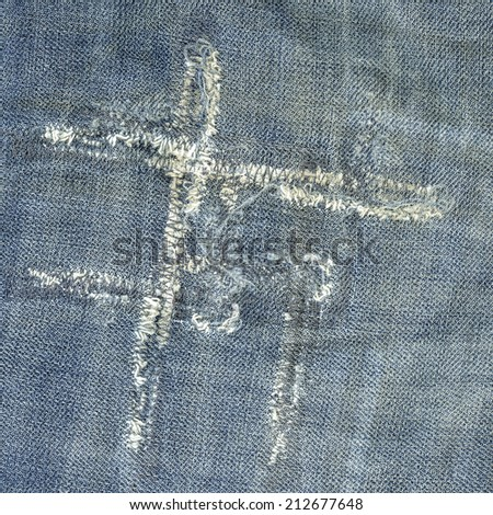 fragment of old worn blue jeans, seams  - stock photo