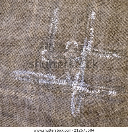 fragment of old worn brown jeans, seams - stock photo