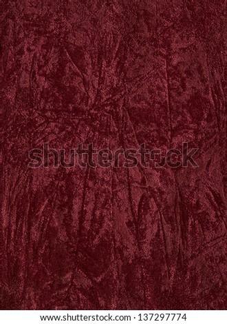 Fragment of red material velvet - stock photo